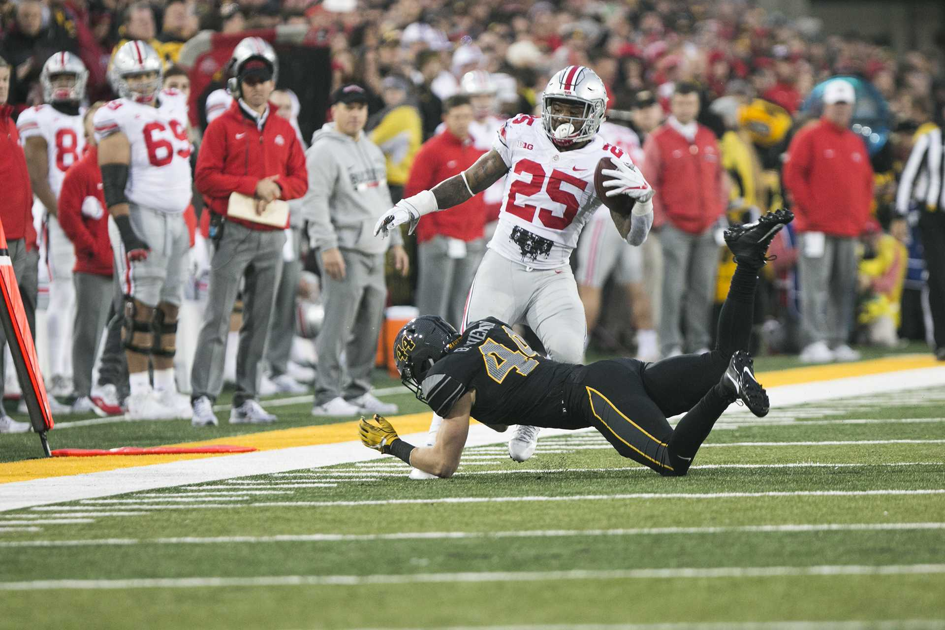 Iowa linebacker Ben Niemann trips up Ohio State running back Mike Weber during the Iowa/Ohio State football game in Kinnick Stadium on Saturday, Nov. 4, 2017. The Hawkeyes defeated the Buckeyes in a storming fashion, 55-24. (Joseph Cress/The Daily Iowan)
