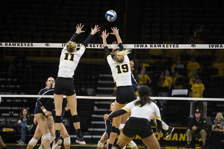 Iowas Kelsey ONeill (11) and Taylin Alm (19) attempt to block a shot from Penn States Simone Lee during the match between Iowa and Penn State at Carver-Hawkeye Arena on Wednesday, Nov. 8, 2017. The Hawkeyes lost to the Nittany Lions 3-0.