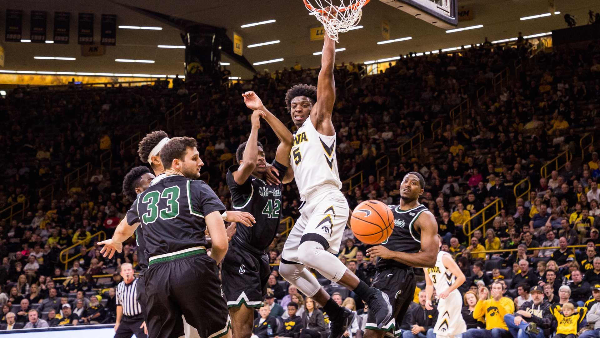 Iowa's Tyler Cook hangs on the rim after dunking in a game against Chicago State University on Friday, 10. Nov, 2017. The Hawkeyes defeated the Cougars, 95-62. (David Harmantas/The Daily Iowan)