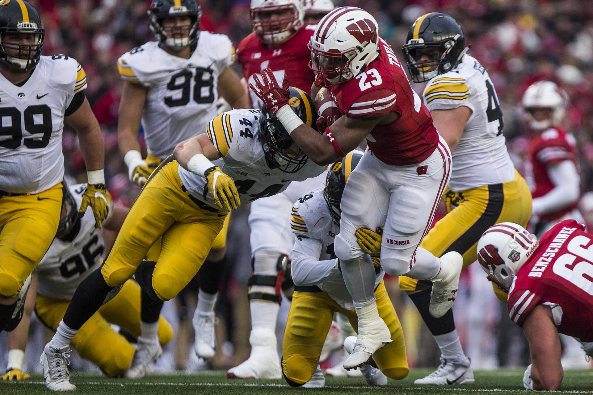 Wisconsin running back Jonathan Taylor (23) is tackled by Iowa linebacker Ben Niemann (44) just before the goal line during the game between Iowa and Wisconsin at Camp Randall Stadium on Saturday, Nov. 11, 2017. The Hawkeyes fell to the Badgers 38-14. (Ben Smith/The Daily Iowan)