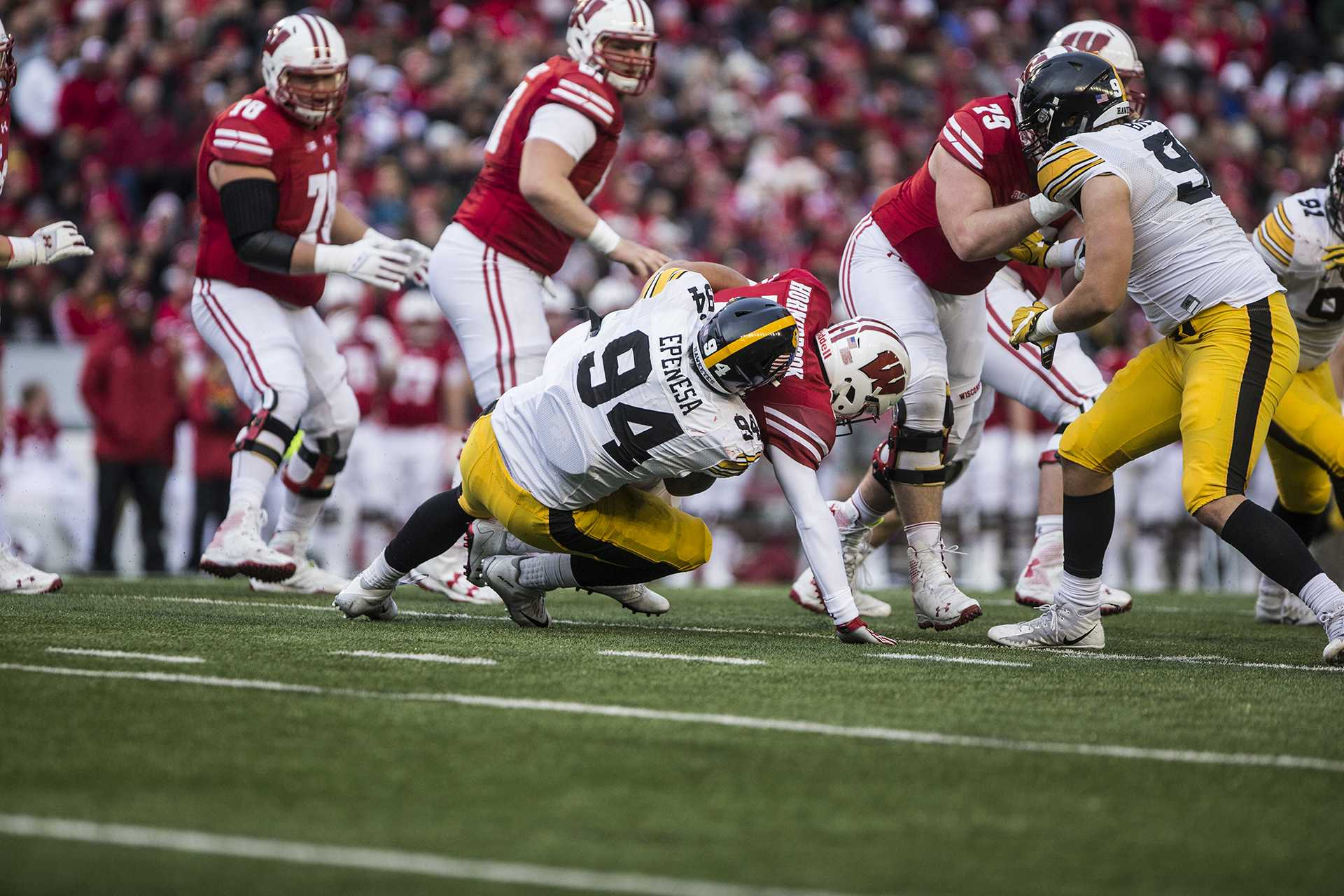Iowa defensive end A.J. Epenesa (94) sacks Wisconsin quarterback Alex Hornibrook (12) during the game between Iowa and Wisconsin at Camp Randall Stadium on Saturday, Nov. 11, 2017. The Hawkeyes fell to the Badgers 38-14.