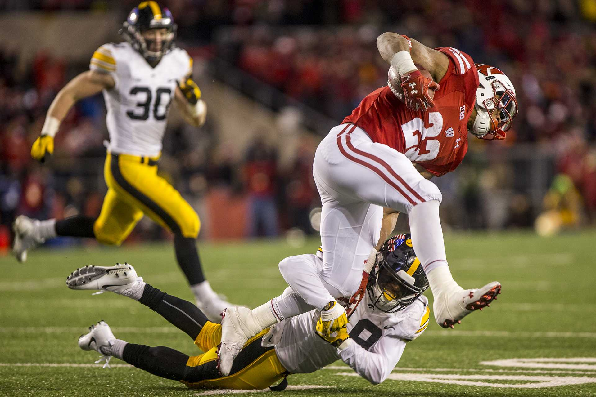 Iowa cornerback Miles Taylor tackles Wisconsin running back Jonathan Taylor during Iowa's game against Wisconsin at Camp Randall Stadium on Saturday, Nov. 11, 2017. The badgers defeated the Hawkeyes 38-14. (Nick Rohlman/The Daily Iowan)