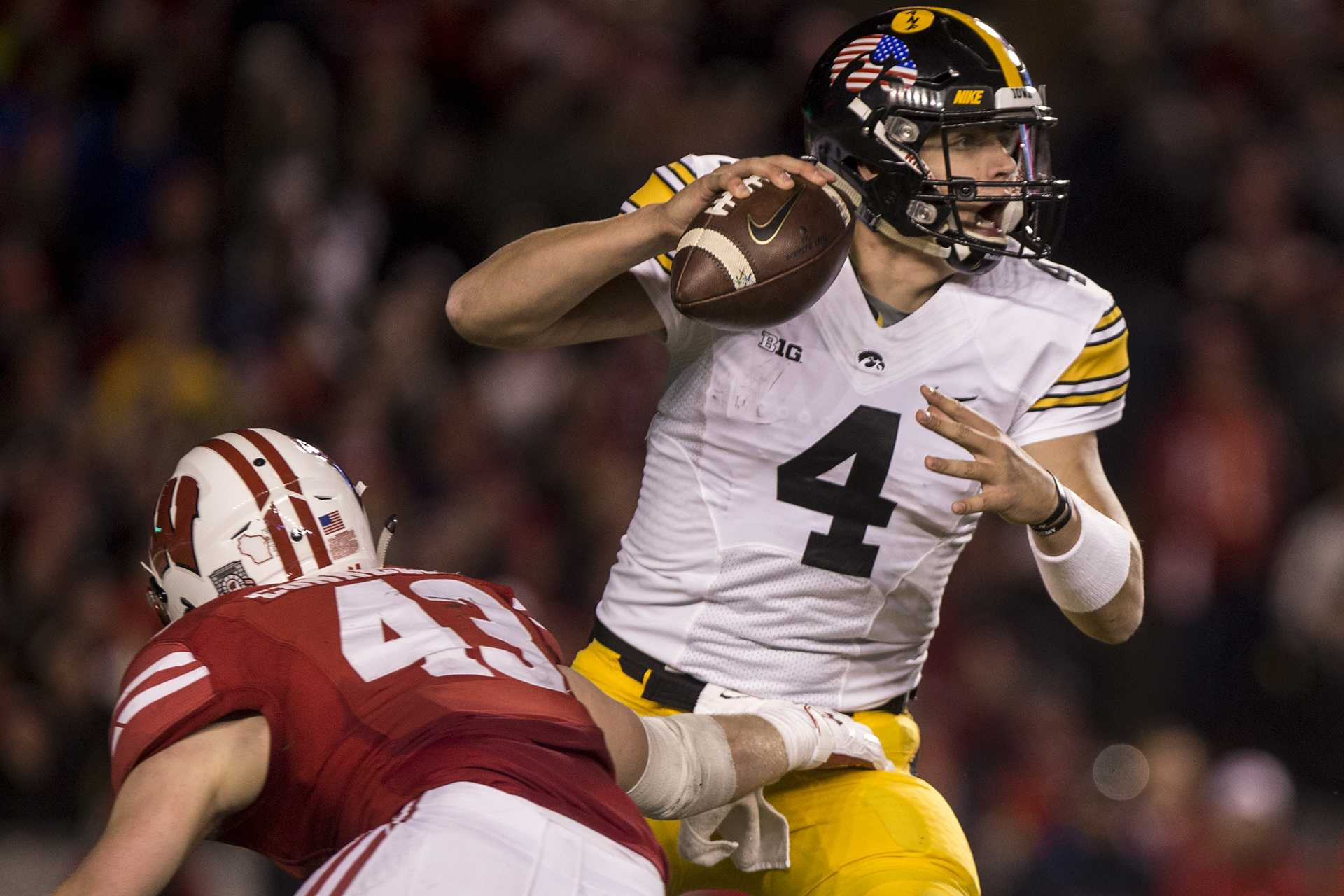 Iowa quarterback Nate Stanley attempts to avoid the blitz during Iowa's game against Wisconsin at Camp Randall Stadium on Saturday, Nov. 11, 2017. The badgers defeated the Hawkeyes 38-14. (Nick Rohlman/The Daily Iowan)