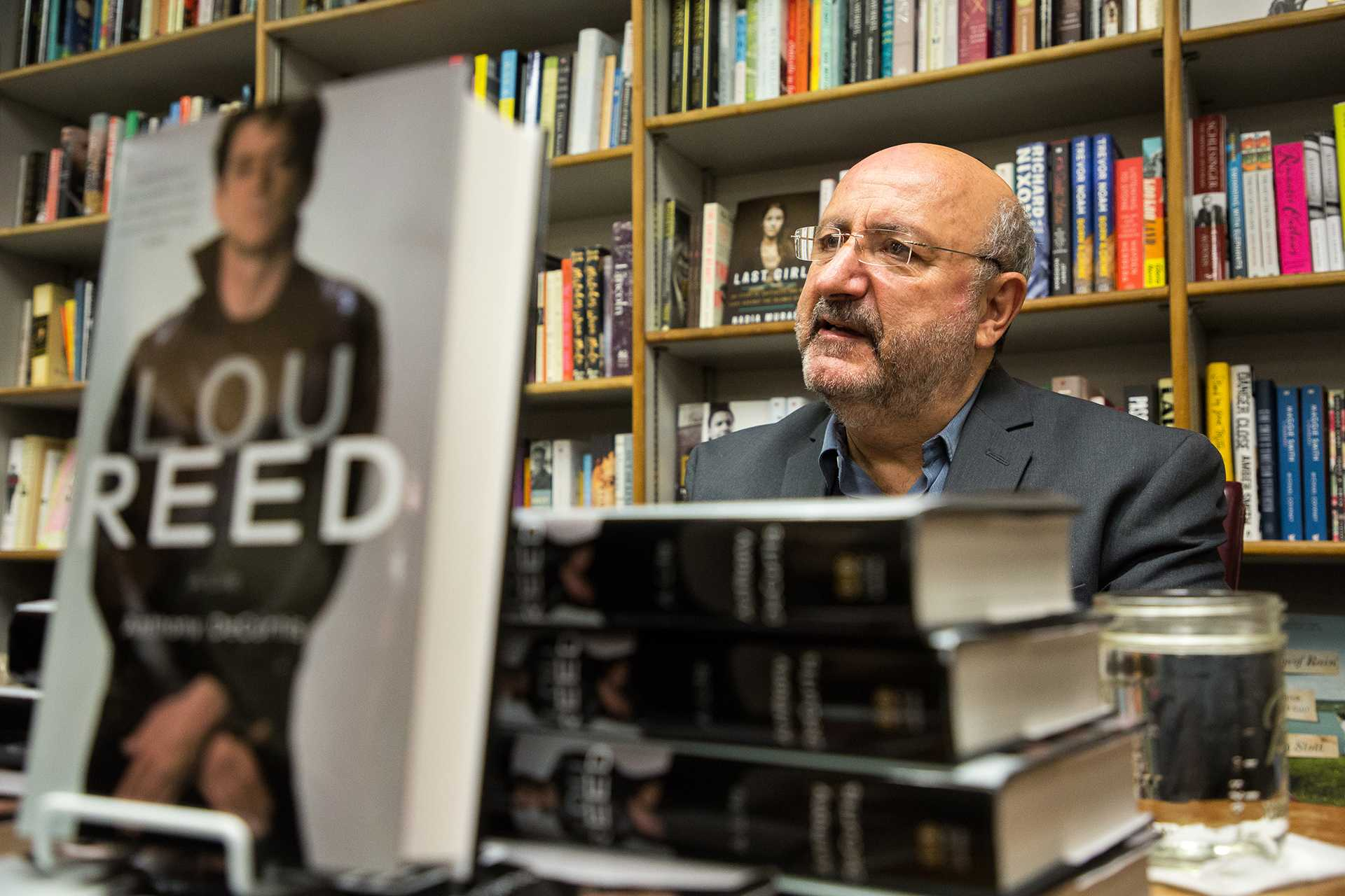 """Anthony Decurtis speaks to patrons at Prairie Lights bookstore after giving a reading from and answering questions about his new biography titled """"Lou Reed: A Life"""" on Monday, Nov. 13, 2017. Lou Reed fronted the band """"The Velvet Underground"""" and was a hugely influential musician who helped inspire alternative rock.  (David Harmantas/The Daily Iowan)"""