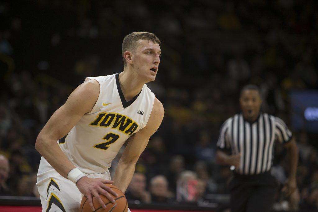 Iowa+forward+Jack+Nunge+prepares+to+pass+during+a+basketball+match+between+Iowa+and+Grambling+State+on+Thursday%2C+November+16%2C+2017.+The+Hawkeyes+defeated+the+Tigers%2C+85-74.+%28Shivansh+Ahuja%2FThe+Daily+Iowan%29