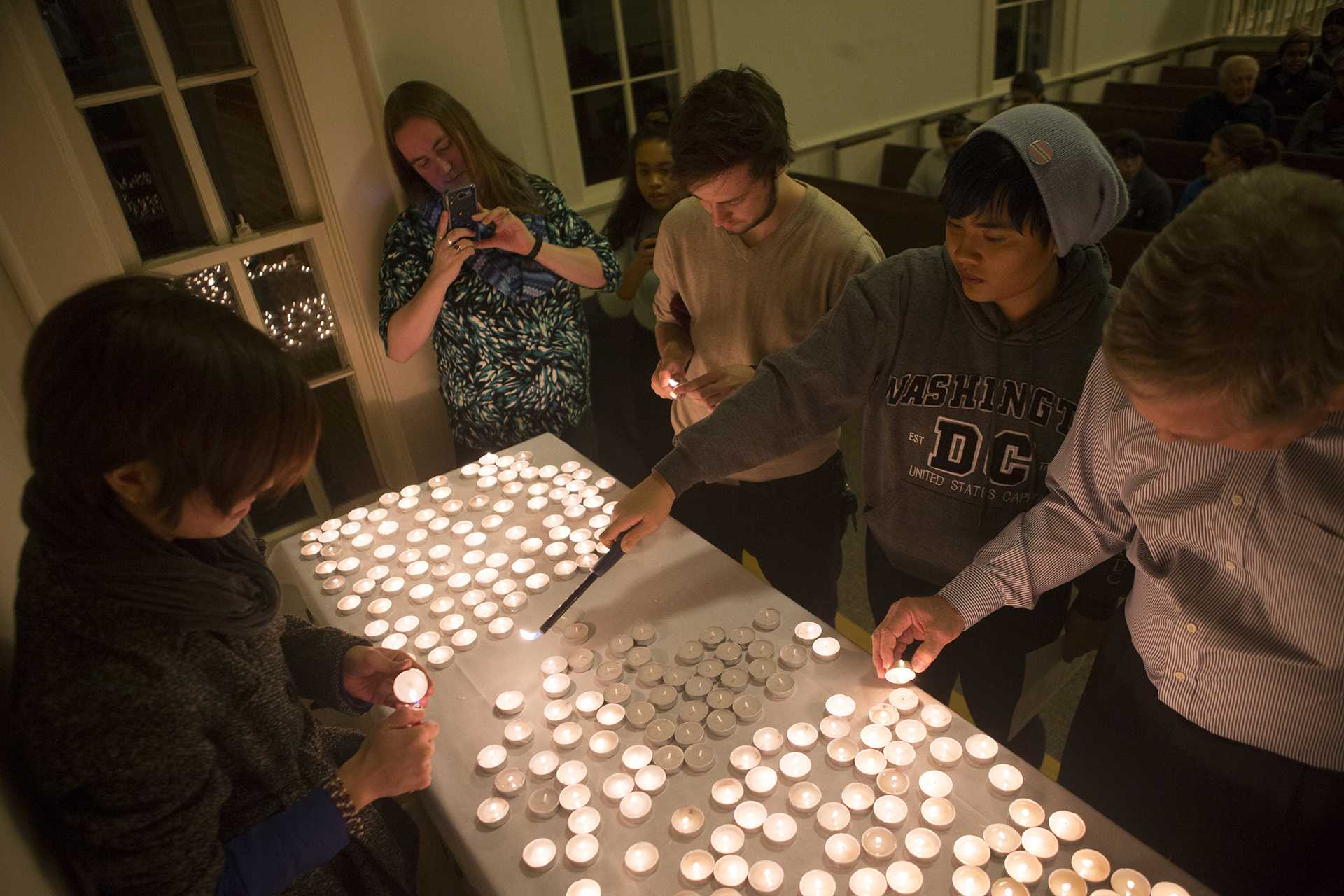 Attendees light candles during the Trans Day of Remembrance Vigil in Danforth Chapel on Thursday, Nov. 16, 2017. The event included the reading of 284 murdered trans peoples' names. (Lily Smith/The Daily Iowan)