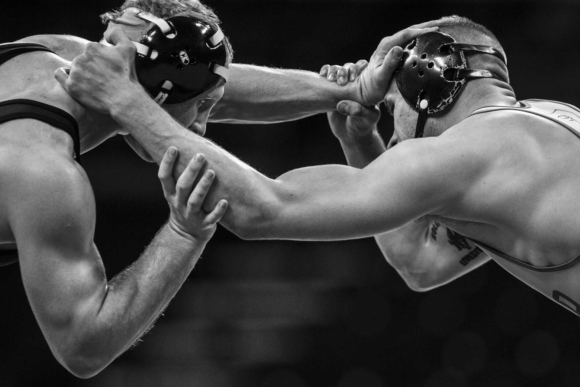 Iowa's Kaleb Young (165 lbs.) competes against Buffalo's Derek Holcomb during the Iowa City Duals wrestling match at Carver-Hawkeye Arena on Friday, Nov. 17, 2017. The Hawkeyes defeated Iowa Central 48-0, Buffalo 33-6, and North Dakota State 38-6. (Ben Smith/The Daily Iowan)