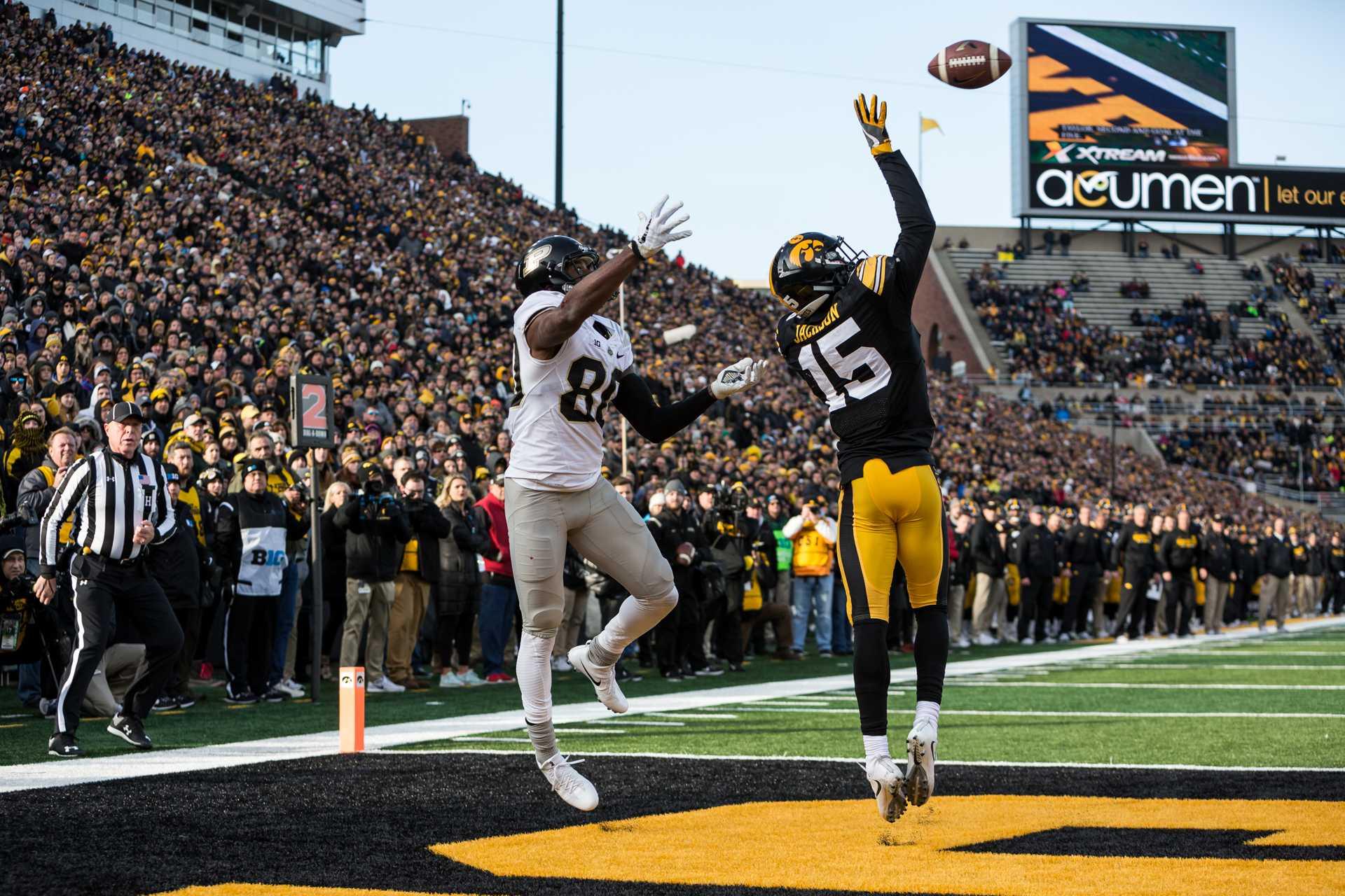 Iowa Defensive Back Josh Jackson breaks up a pass during a game against Purdue University on Saturday, Nov. 18, 2017. (David Harmantas/The Daily Iowan)