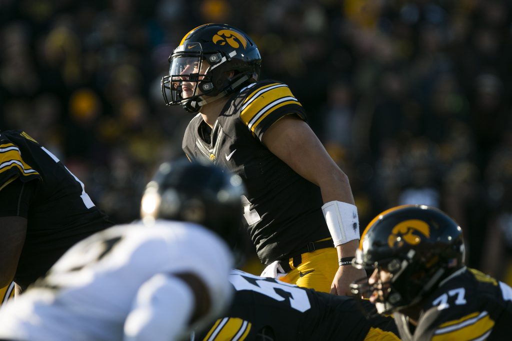 Iowa+quarterback+Nate+Stanley+looks+up+into+the+sun+during+the+Iowa%2FPurdue+football+game+in+Kinnick+Stadium+on+Saturday%2C+Nov.+18%2C+2017.+The+Boilermakers+defeated+the+Hawkeyes%2C+24-15.+%28Joseph+Cress%2FThe+Daily+Iowan%29