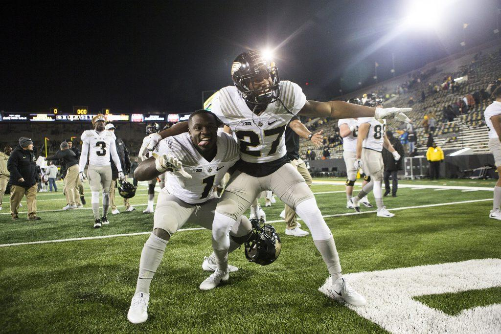 Purdue+running+back+D.J.+Knox+%281%29+and+safety+Navon+Mosley+%2827%29+play+to+cameras+during+the+Iowa%2FPurdue+football+game+in+Kinnick+Stadium+on+Saturday%2C+Nov.+18%2C+2017.+The+Boilermakers+defeated+the+Hawkeyes%2C+24-15.+%28Joseph+Cress%2FThe+Daily+Iowan%29