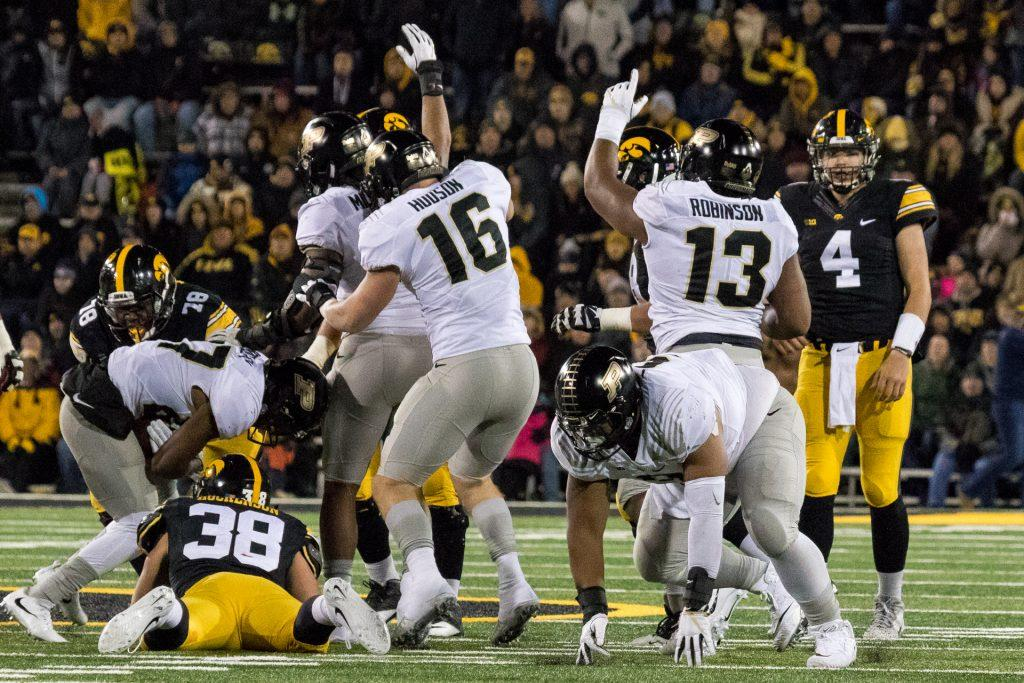 Iowa+Quarterback+Nate+Stanley+looks+on+as+the+Purdue+defense+celebrates+recovering+a+fumble+during+a+game+on+Saturday%2C+Nov.+18%2C+2017.+The+Boilermakers+defeated+the+Hawkeyes+24+to+15.+%28David+Harmantas%2FThe+Daily+Iowan%29