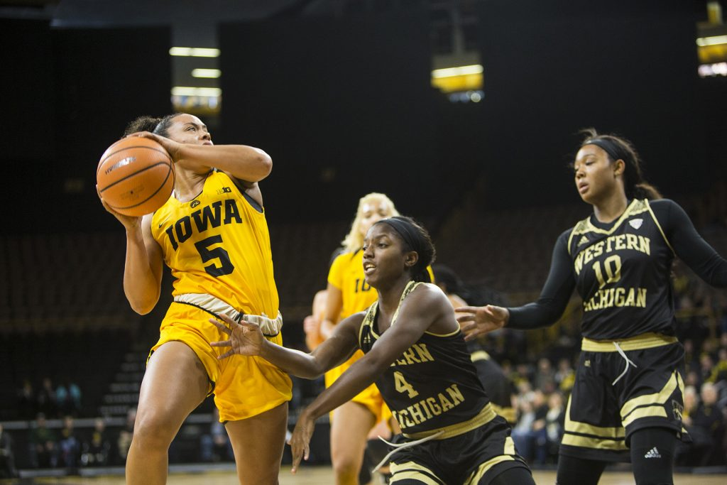 Iowa+guard+Alexis+Sevillian+takes+a+shot+over+Western+Michigan+guard+Deja+Wimbly+during+the+Iowa%2FWestern+Michigan+women%27s+basketball+game+in+Carver-Hawkeye+Arena+on+Sunday%2C+Nov.+19%2C+2017.+The+Hawkeyes+defeated+the+Broncos%2C+79-56.+%28Joseph+Cress%2FThe+Daily+Iowan%29