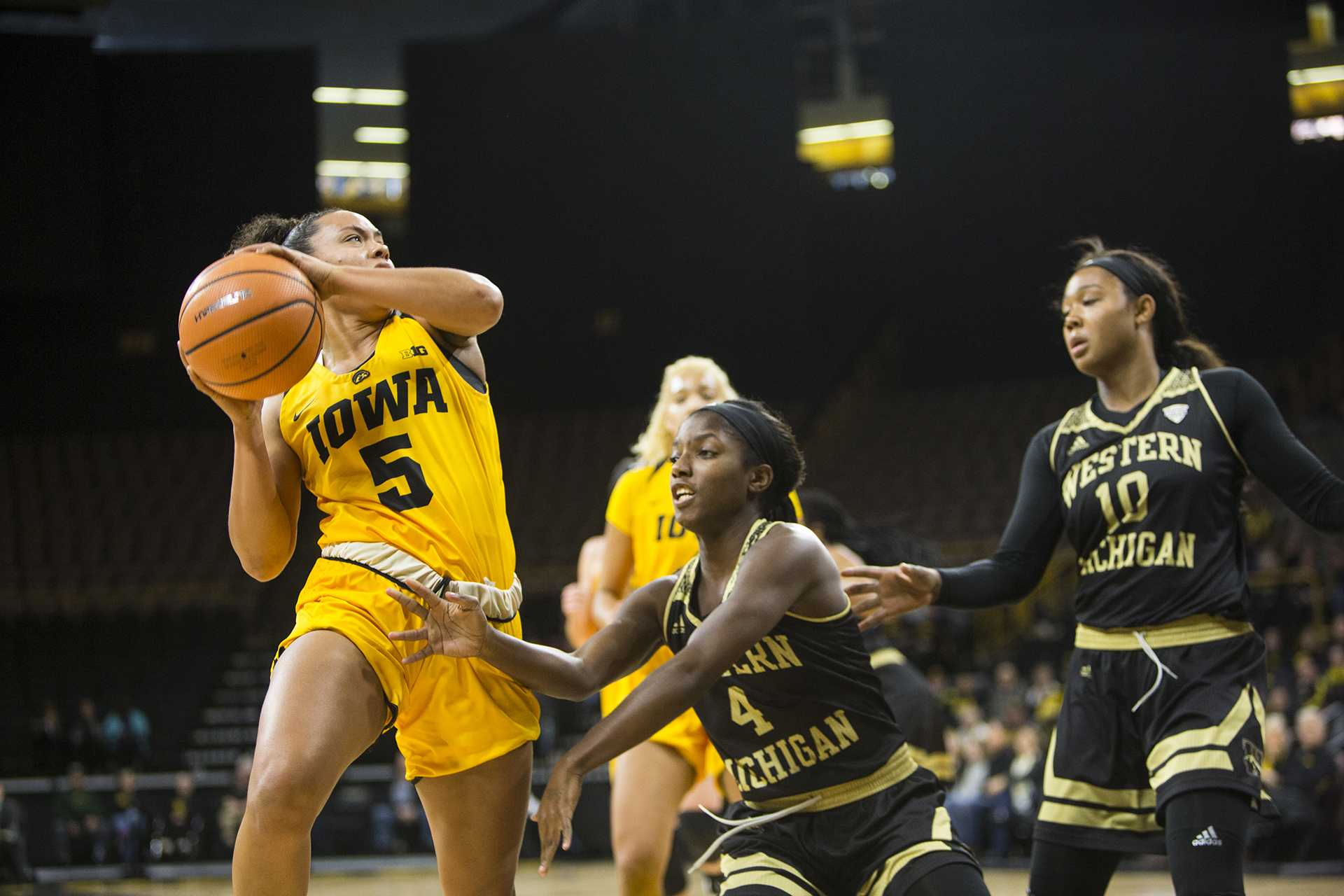 Iowa guard Alexis Sevillian takes a shot over Western Michigan guard Deja Wimbly during the Iowa/Western Michigan women's basketball game in Carver-Hawkeye Arena on Sunday, Nov. 19, 2017. The Hawkeyes defeated the Broncos, 79-56. (Joseph Cress/The Daily Iowan)