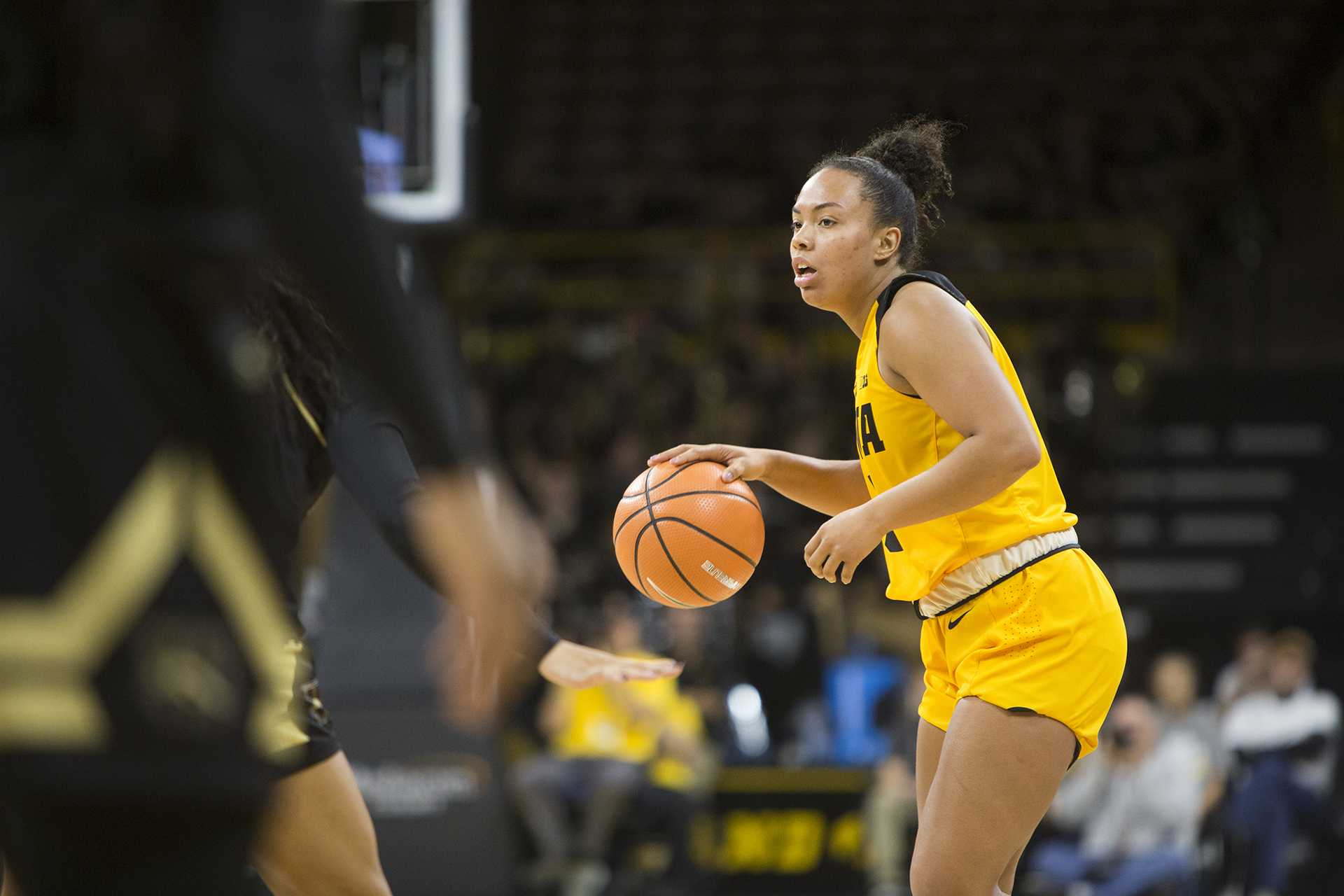 Iowa guard Alexis Sevillian dribbles during the Iowa/Western Michigan women's basketball game in Carver-Hawkeye Arena on Sunday, Nov. 19, 2017. The Hawkeyes defeated the Broncos, 79-56. (Joseph Cress/The Daily Iowan)