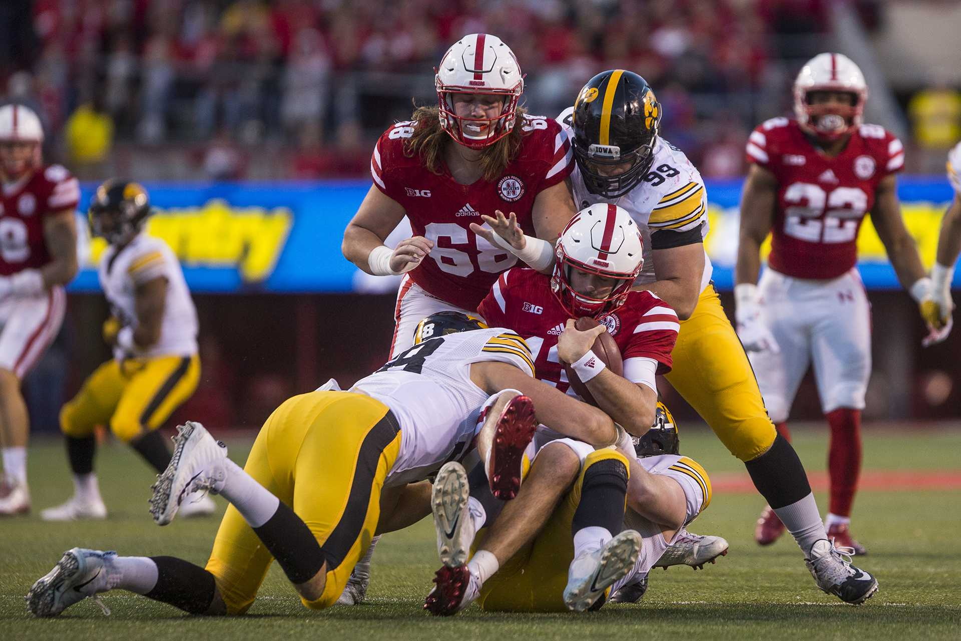 Nebraska quarterback Tanner Lee is sacked by Iowa defensive ends Parker Hesse and Anthony Nelson during Iowa's game against Nebraska at Memorial Stadium on Friday, Nov. 24, 2017. The Hawkeyes defeated the Cornhuskers 56-14.