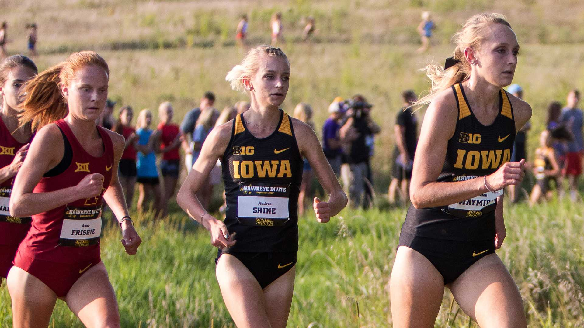 Madison Waymire (right) and Andrea Shine run up a hill at the Hawkeye Invitational Cross Country meet on Friday, September 1, 2017. (David Harmantas/The Daily Iowan)
