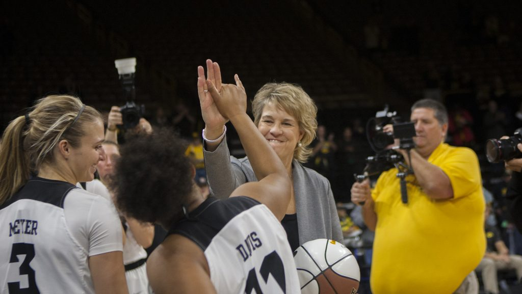 Head+coach+Lisa+Bluder+high+fives+Iowa+guard+Tania+Davis+during+the+Iowa%2FQuinnipiac+basketball+game+at+Carver-Hawkeye+Arena+on+Friday%2C+Nov.+10%2C+2017.+The+Hawkeyes+defeated+the+Bobcats%2C+83-67%2C+for+head+coach+Lisa+Bluder%27s+700+career+win.+%28Lily+Smith%2FThe+Daily+Iowan%29
