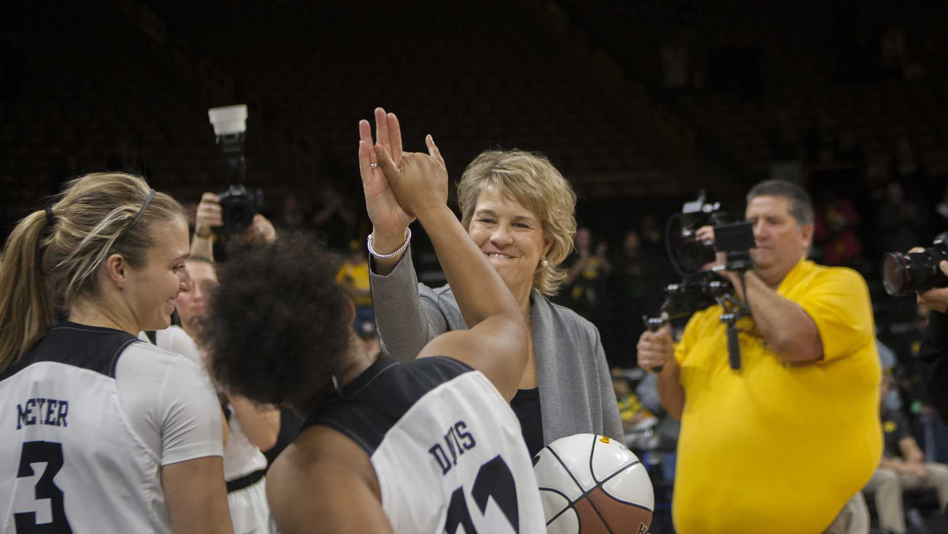 Head coach Lisa Bluder high fives Iowa guard Tania Davis during the Iowa/Quinnipiac basketball game at Carver-Hawkeye Arena on Friday, Nov. 10, 2017. The Hawkeyes defeated the Bobcats, 83-67, for head coach Lisa Bluder's 700 career win. (Lily Smith/The Daily Iowan)