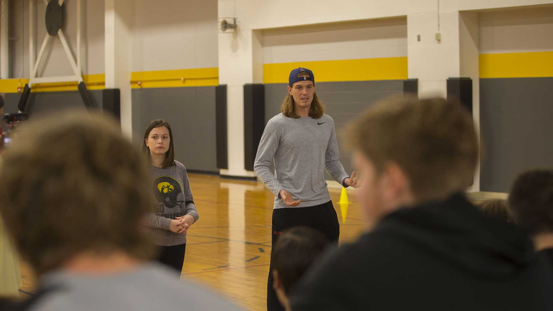 From left: UI students Mellisa McLihon and Ben Flaherty speaks at the Big Brothers Big Sisters soccer game in the Fieldhouse on Sunday, Nov. 5, 2017. (Lily Smith/The Daily Iowan)