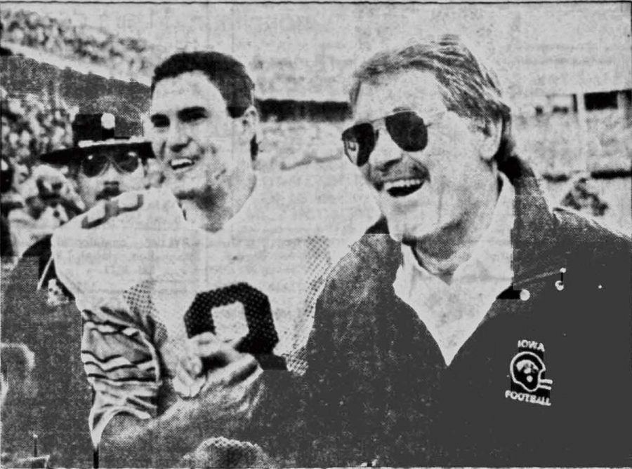 Iowa quarterback Chuck Hartlieb and Iowa coach Hayden Fry embrace after the Hawkeyes' victory over Ohio State on Saturday Nov.14, 1987. (Daily Iowan archives)