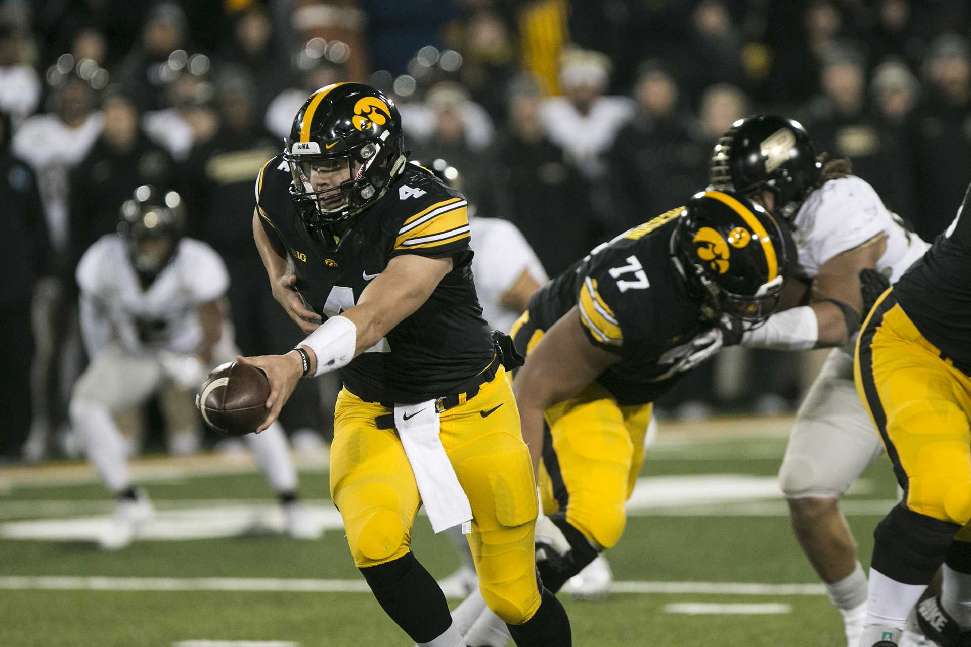 Iowa quarterback Nate Stanley hands a ball off during the Iowa/Purdue football game in Kinnick Stadium on Saturday, Nov. 18, 2017. The Boilermakers defeated the Hawkeyes, 24-15. (Joseph Cress/The Daily Iowan)