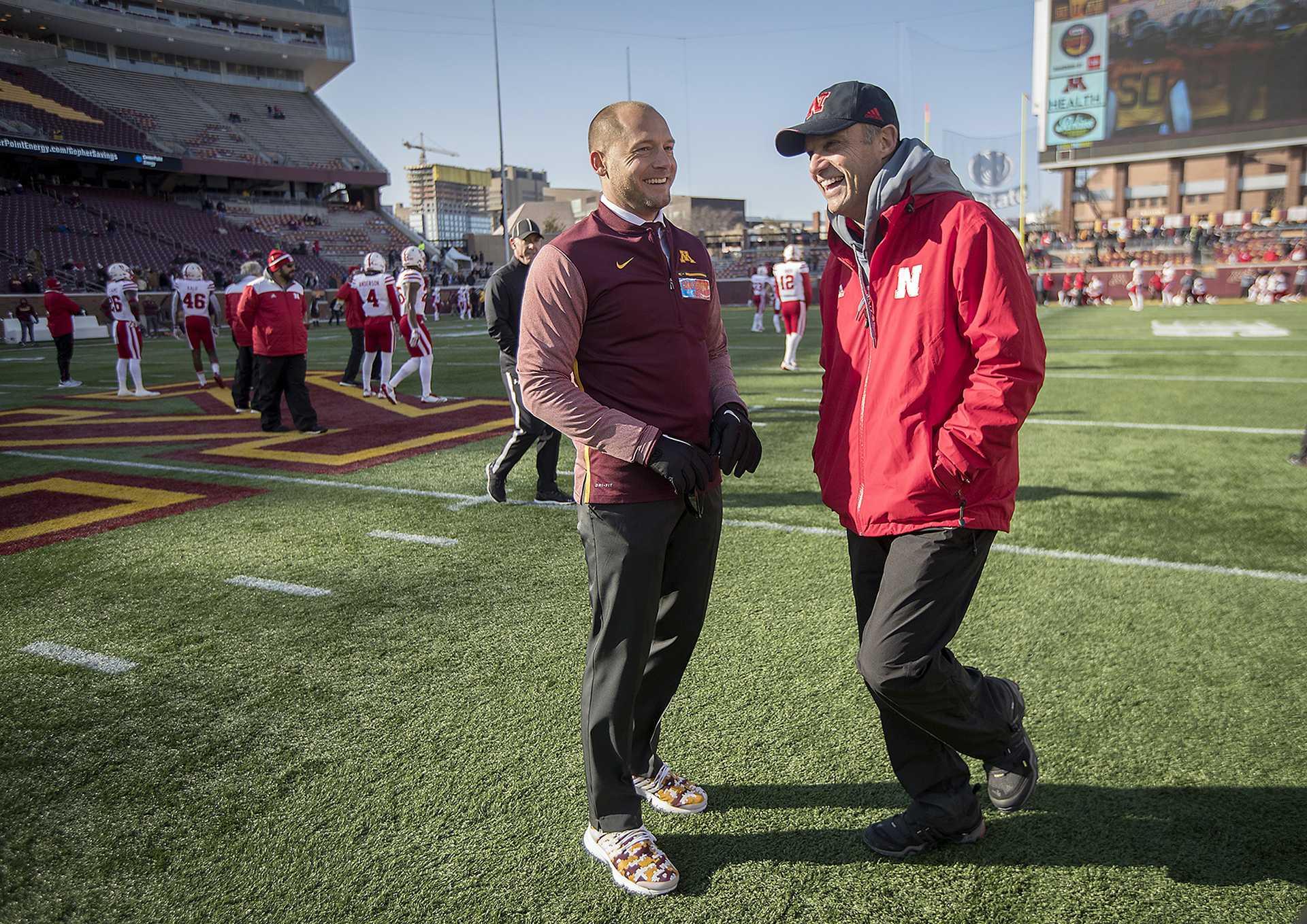 Minnesota head coach P. J. Fleck, right, and Nebraska head coach Mike Riley greet each other on the field before the Gophers took on Nebraska on Saturday, Nov. 11, 2017 at TCF Bank Stadium in Minneapolis, Minn. (Elizabeth Flores/Minneapolis Star Tribune/TNS)