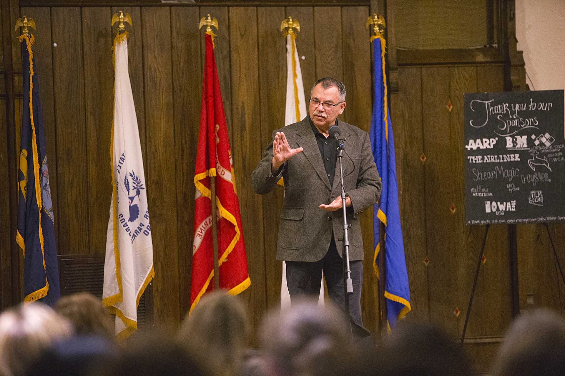 Dr. Jon Kerstetter speaks at a fundraiser for Iowa Watch on Thursday, Nov. 9, 2017. Dr. Kersetter spoke about his experiences as a military doctor and about dealing with memory issues resulting from complications of injuries sustained while serving. (Nick Rohlman/The Daily Iowan)