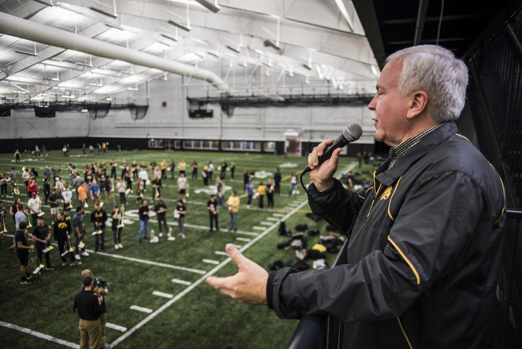 UI Marching Band Director Kevin Kastens directs the Hawkeye Marching Band during the second-to-last band practice of the season at the Hawkeye Tennis and Recreation Center on Thursday, Nov. 16. Kastens is retiring this year after 20 years in multiple directorial positions at the University. (Ben Smith/The Daily Iowan)