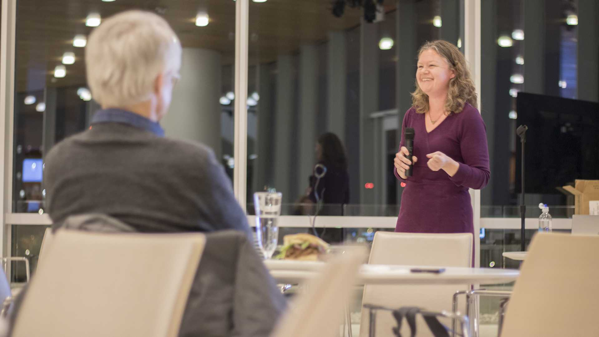 Dr. Brandi Jannsen smiles during a presentation on small-scale farming in Iowa at Hancher Auditorium on Thursday, Nov. 9, 2017. The talk covered the way local and global food systems overlap. (Shivansh Ahuja/The Daily Iowan)