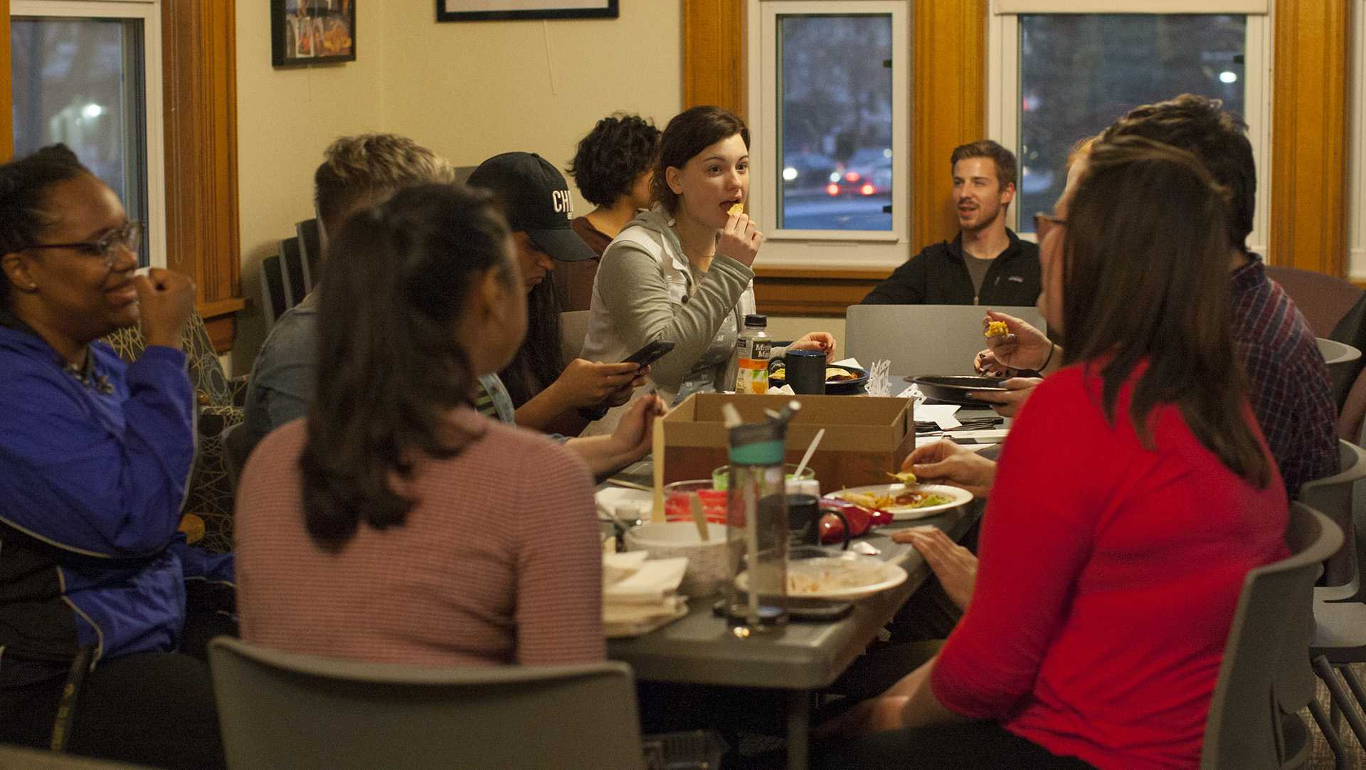Student volunteers meet up at the Women's Resource & Action Center on Thursday, Nov. 20, 2017, to recognize their contributions for the semester. (Katie Goodale/The Daily Iowan)