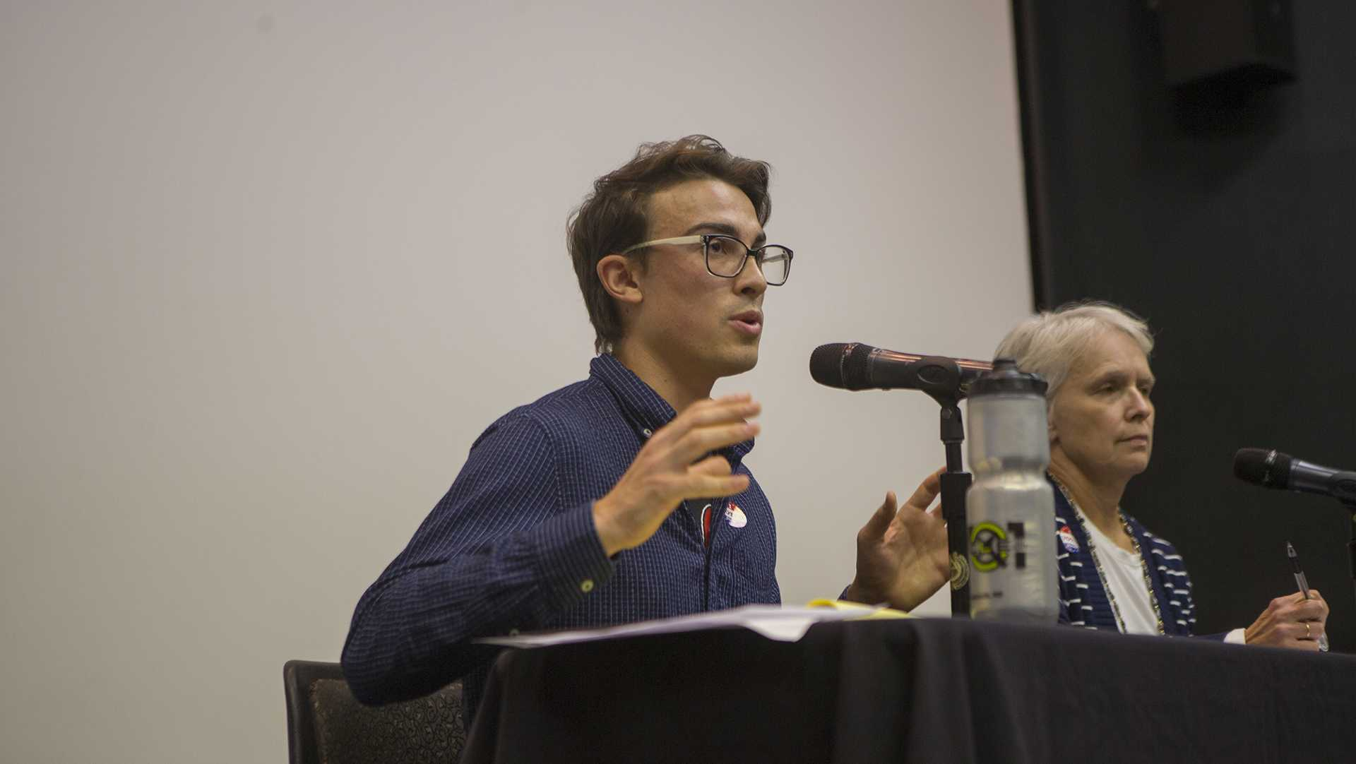Iowa City City Council District B candidate Ryan Hall speaks during the UISG City Council Forum in the IMU on Wednesday, Oct. 18, 2017. The event gave students and community members the opportunity to ask city council candidates about various issues. (Lily Smith/The Daily Iowan)