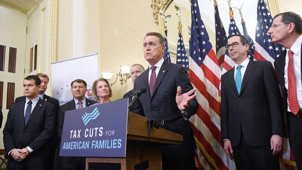 Republican+Sen.+David+Perdue%2C+with+other+GOP+senators+and+Treasury+Secretary+Steven+Mnuchin%2C+speaks+during+a+news+conference+on+tax+reform+at+the+Capitol+on+Tuesday%2C+Nov.+7%2C+2017+in+Washington%2C+D.C.+%28Olivier+Douliery%2FAbaca+Press%2FTNS%29