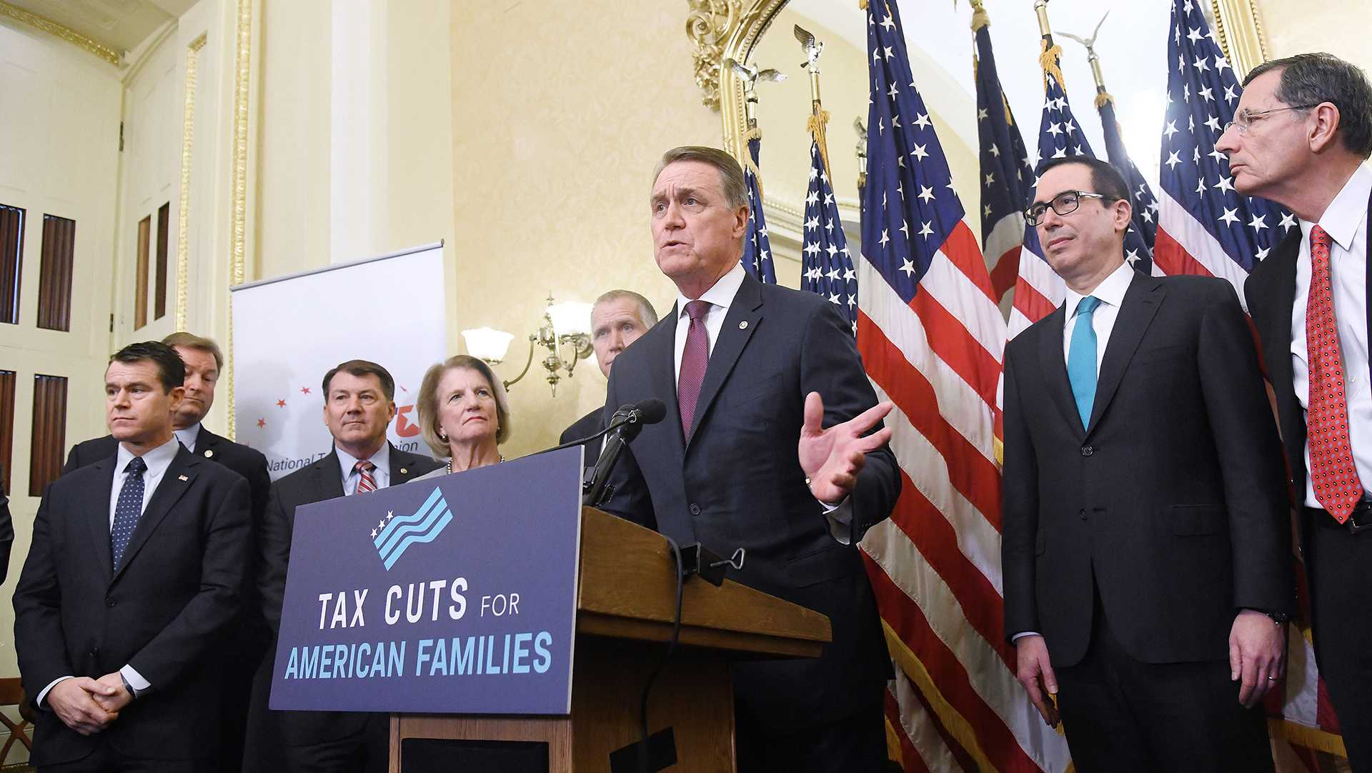 Republican Sen. David Perdue, with other GOP senators and Treasury Secretary Steven Mnuchin, speaks during a news conference on tax reform at the Capitol on Tuesday, Nov. 7, 2017 in Washington, D.C. (Olivier Douliery/Abaca Press/TNS)