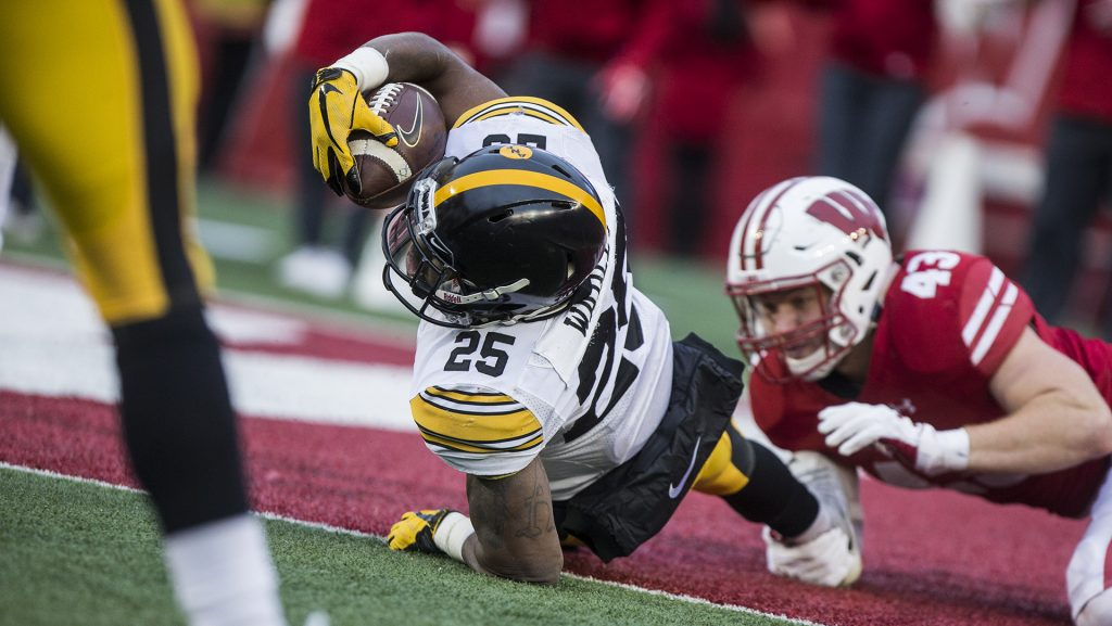 Iowa+running+back+Akrum+Wadley+%2825%29+is+tackled+by+Wisconsin%27s+Ryan+Connelly+%2843%29+just+shy+of+the+end+zone+during+the+game+between+Iowa+and+Wisconsin+at+Camp+Randall+Stadium+on+Saturday%2C+Nov.+11%2C+2017.+The+Hawkeyes+fell+to+the+Badgers+38-14.+%28Ben+Smith%2FThe+Daily+Iowan%29