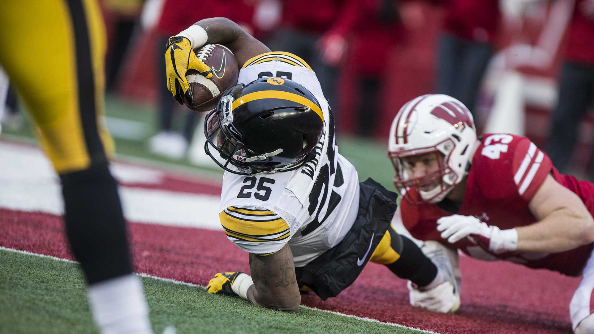 Iowa running back Akrum Wadley (25) is tackled by Wisconsin's Ryan Connelly (43) just shy of the end zone during the game between Iowa and Wisconsin at Camp Randall Stadium on Saturday, Nov. 11, 2017. The Hawkeyes fell to the Badgers 38-14. (Ben Smith/The Daily Iowan)
