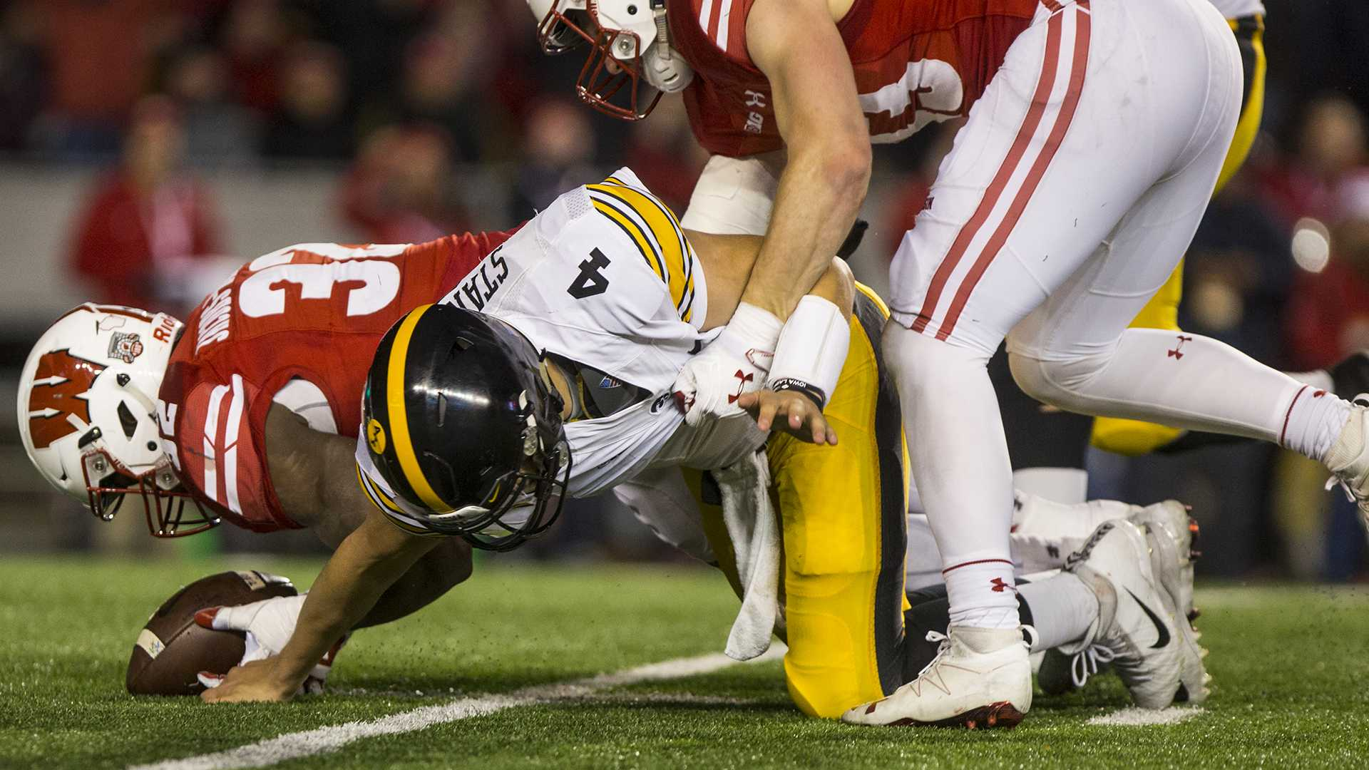 Iowa quarterback Nate Stanley is hit after fumbling the ball during Iowa's game against Wisconsin at Camp Randall Stadium on Saturday, Nov. 11, 2017. The badgers defeated the Hawkeyes 38-14. (Nick Rohlman/The Daily Iowan)