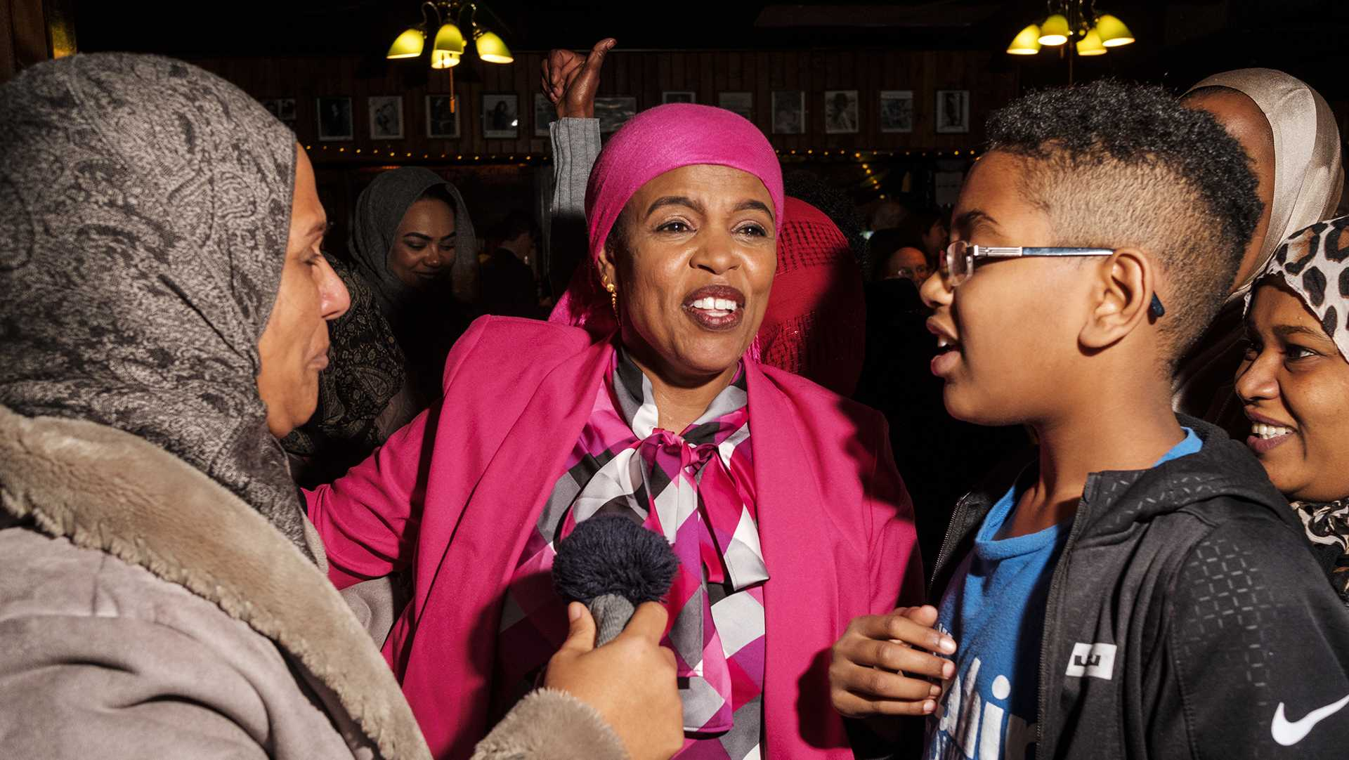 Mazahir Salih is congratulated by suporters and family members after election results were announced at the Mill in Iowa City on Tuesday, Nov. 7, 2017. Salih won an at large seat on the Iowa City city council along with incumbent Kingsley Botchway. (Nick Rohlman/The Daily Iowan)