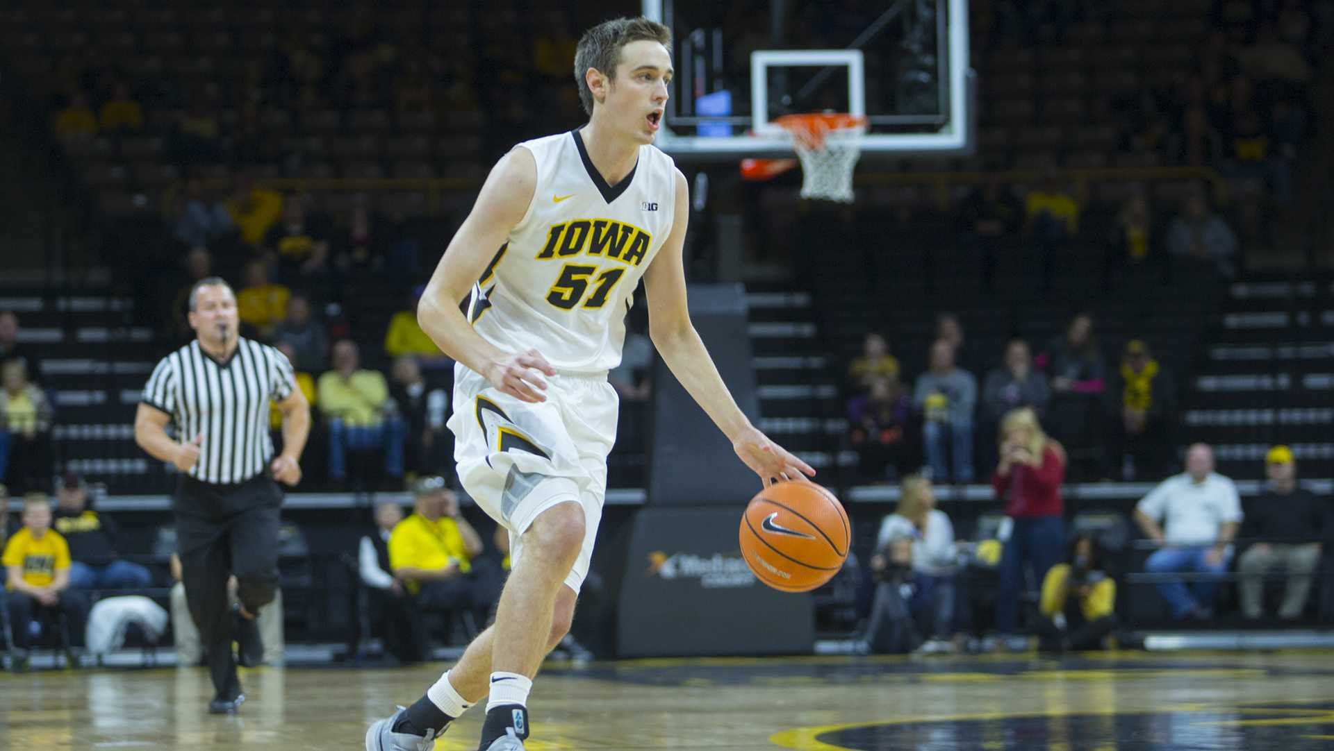 Iowa forward Nicholas Baer dribbles the ball during the Iowa/Belmont Abbey basketball game in Carver-Hawkeye Arena on Thursday, Nov. 2, 2017. The Hawkeyes defeated the Crusaders, 96-64. (Lily Smith/The Daily Iowan)
