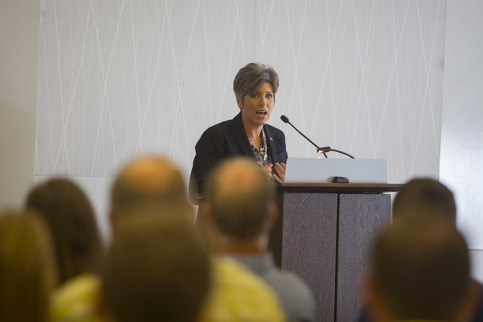 Senator Joni Ernst (R-IA) speaks during a US Service Academy Open House in the Cedar Rapids Public Library on Saturday, June 24, 2017. Sen. Ernst met with prospective military families and protesters alike to answer questions both on and off par with the event. (Lily Smith/The Daily Iowan)