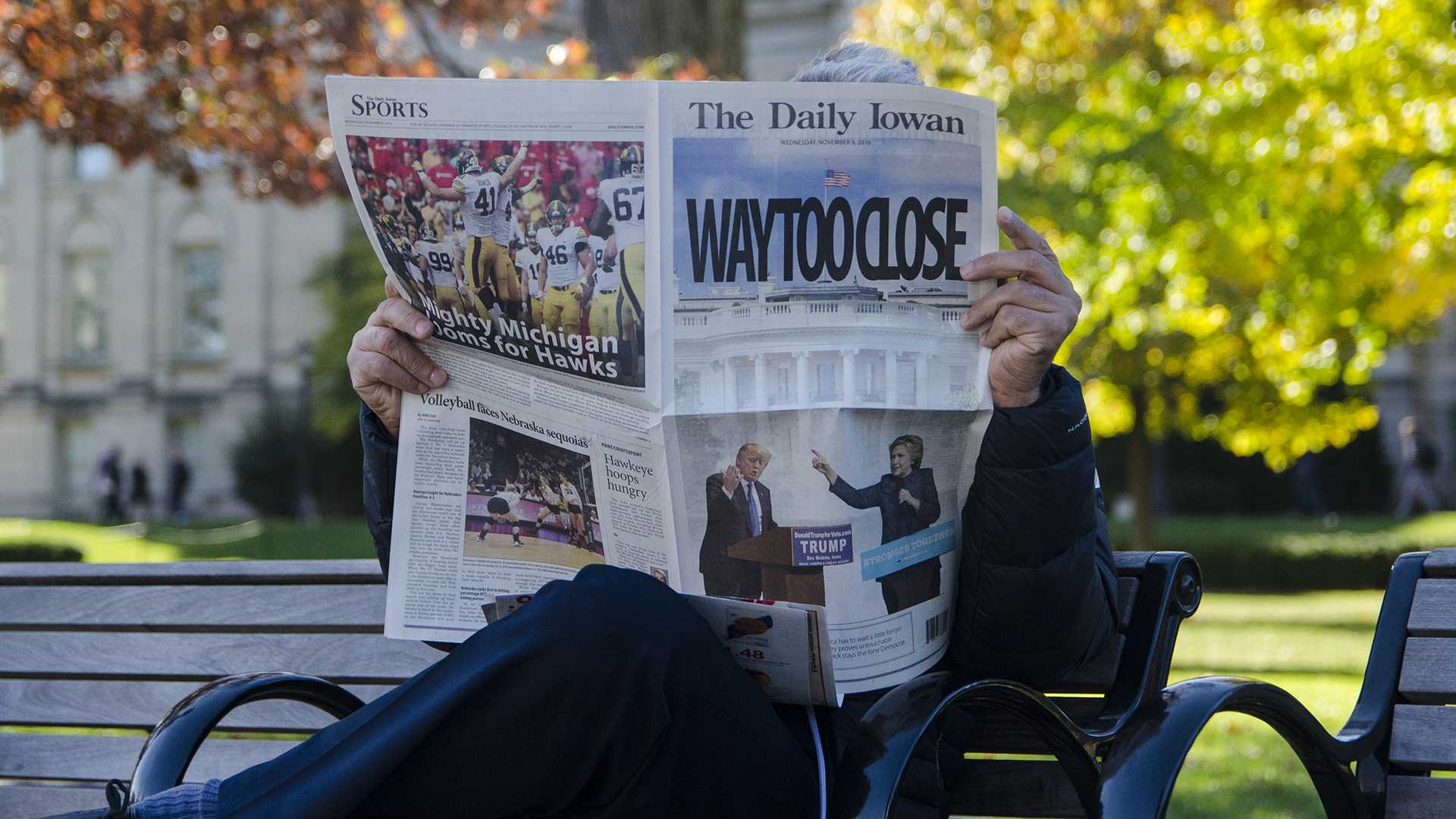 A man reads a paper at a