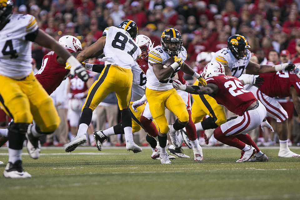 Iowa+running+back+Akrum+Wadley+sheds+a+tackle+during+the+Iowa%2FNebraska+football+game+in+Memorial+Stadium+on+Friday%2C+Nov.+24%2C+2017.+The+Hawkeyes+defeated+the+Cornhuskers%2C+56-14.+%28Joseph+Cress%2FThe+Daily+Iowan%29