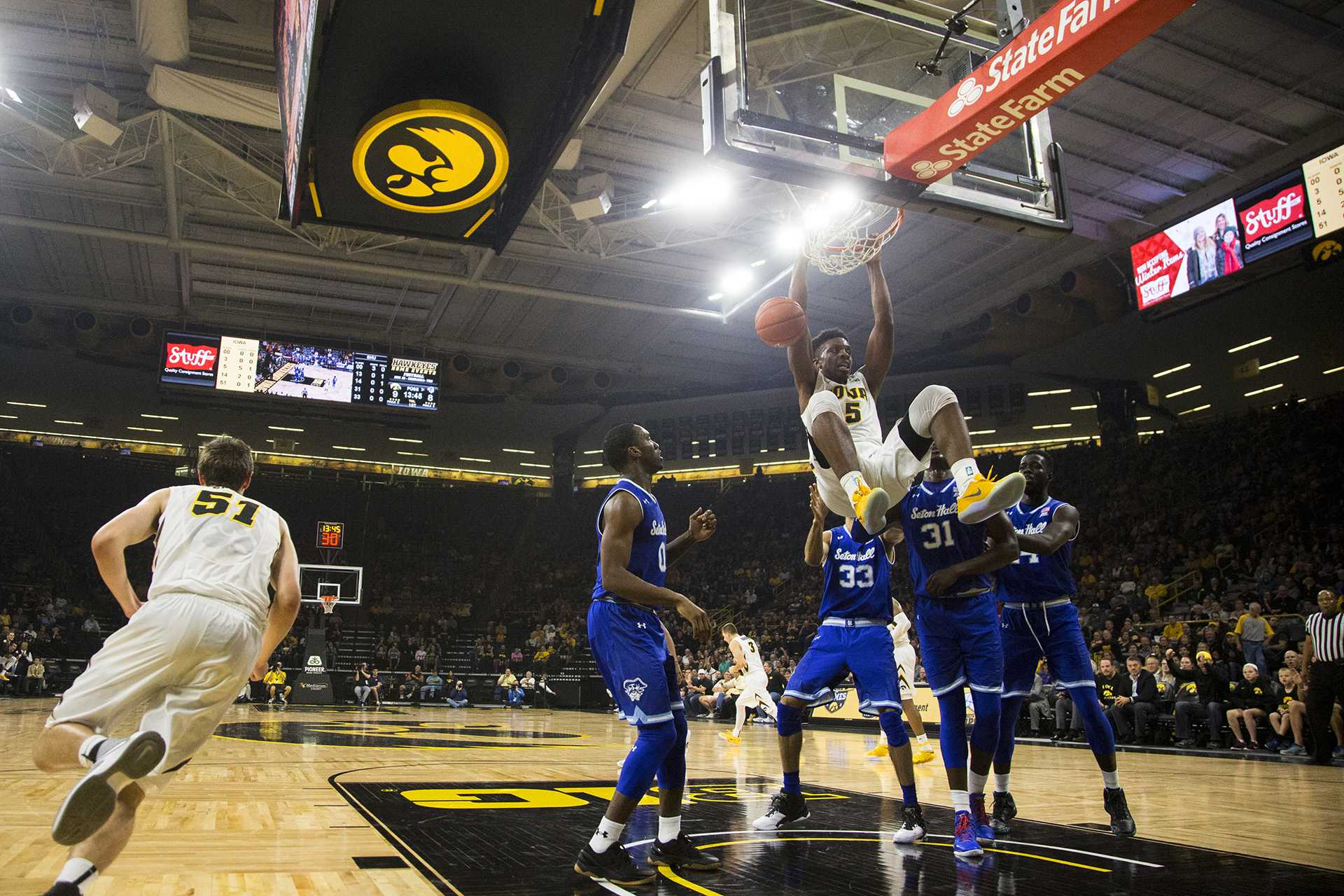 Iowa forward Tyler Cook hangs from the rim after dunking in Carver-Hawkeye on Thursday, Nov. 17, 2016. Cook averaged 12.3 points per game last season, second on the team behind Peter Jok. (Joseph Cress/The Daily Iowan)