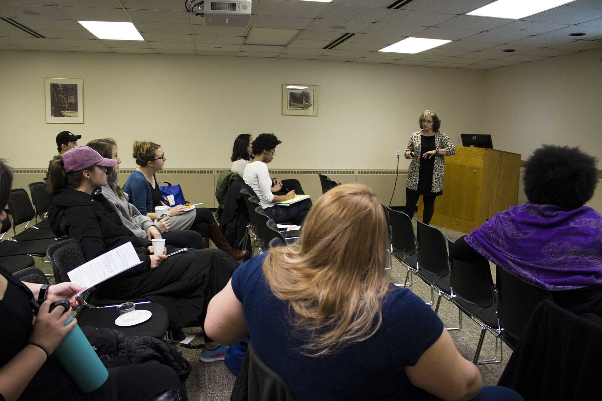 Audience members listen as Shelter House executive director Crissy Canganelli speaks about homelessness in Johnson county at the Cup O' Justice: Homelessness in Iowa and Our Local Response event in the IMU on Wednesday, Feb. 1, 2017. (The Daily Iowan/Lily Smith)