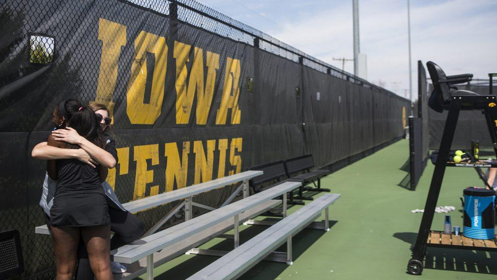 Iowa%27s+Adorabol+Huckleby+hugs+a+friend+after+the+match+against+Penn+State+at+Hawkeye+Tennis+and+Recreation+Complex+on+Sunday%2C+April+9.+The+Hawkeyes+went+on+to+defeat+the+Nittany+Lions+6-1.+%28The+Daily+Iowan%2FBen+Smith%29