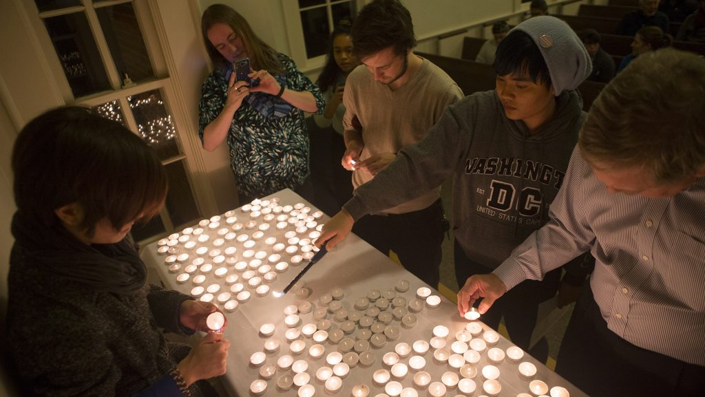 Attendees light candles during the Trans Day of Remembrance Vigil in Danforth Chapel on Thursday, Nov. 16, 2017. The event included the reading of 284 murdered trans peoples names. (Lily Smith/The Daily Iowan)