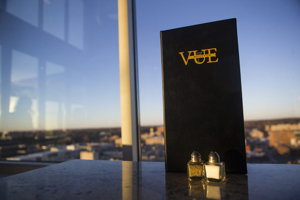 A menu for the Vue rooftop bar is seen during a ribbon cutting event for the Hilton Garden Inn on Clinton Street on Thursday, Nov., 30, 2017. The 12th floor of the hotel features a rooftop bar and restaurant that is open to the public. The hotel opened in October. (Joseph Cress/The Daily Iowan)