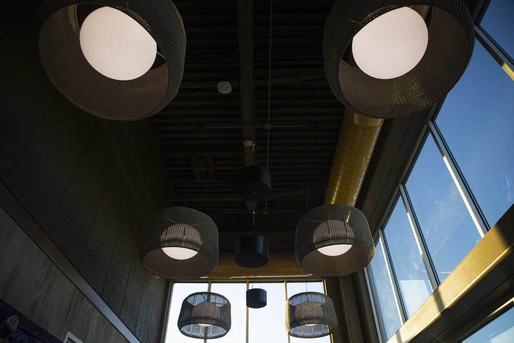 Light fixtures are seen in the Vue rooftop during a ribbon cutting event for the Hilton Garden Inn on Clinton Street on Thursday, Nov., 30, 2017. The 12th floor of the hotel features a rooftop bar and restaurant that is open to the public. The hotel opened in October. (Joseph Cress/The Daily Iowan)