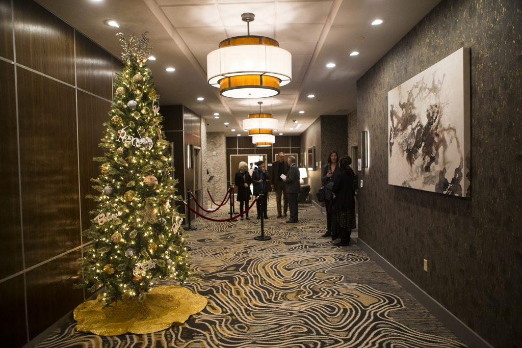 Guests converse during a ribbon cutting event for the Hilton Garden Inn on Clinton Street on Thursday, Nov., 30, 2017. The 12th floor of the hotel features a rooftop bar and restaurant that is open to the public. The hotel opened in October. (Joseph Cress/The Daily Iowan)