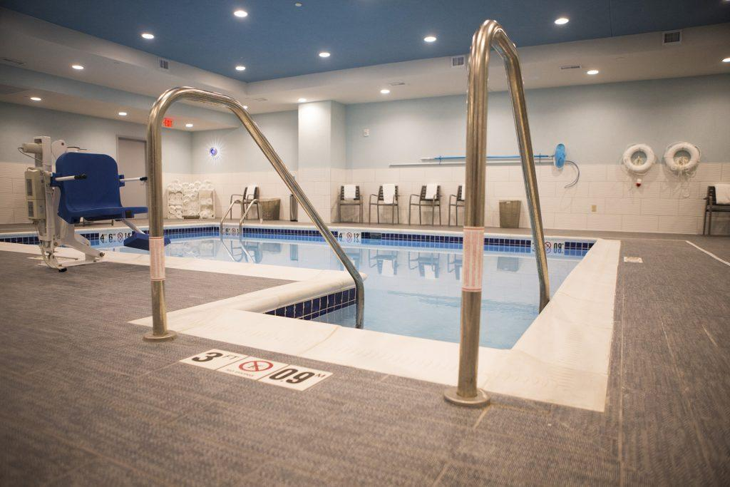 A basement pool is seen during a ribbon cutting event for the Hilton Garden Inn on Clinton Street on Thursday, Nov., 30, 2017. The 12th floor of the hotel features a rooftop bar and restaurant that is open to the public. The hotel opened in October. (Joseph Cress/The Daily Iowan)