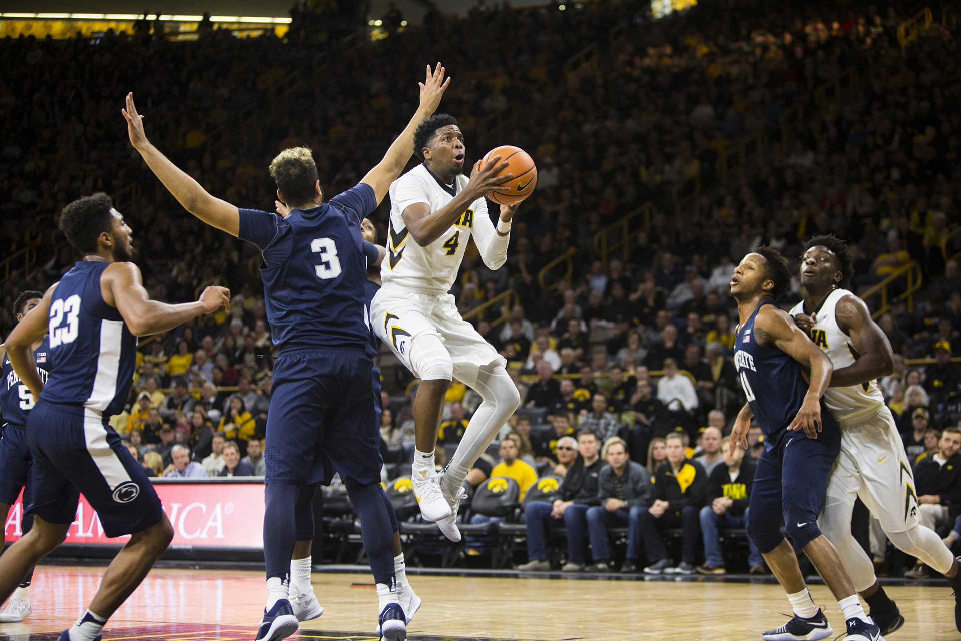 Iowa guard Isaiah Moss attempts a shot past Penn State forward Satchel Pierce during an Iowa/Penn State men's basketball game in Carver-Hawkeye Arena on Saturday, Dec. 2, 2017. The Nittany Lions defeated the Hawkeyes, 77-73. (Joseph Cress/The Daily Iowan)